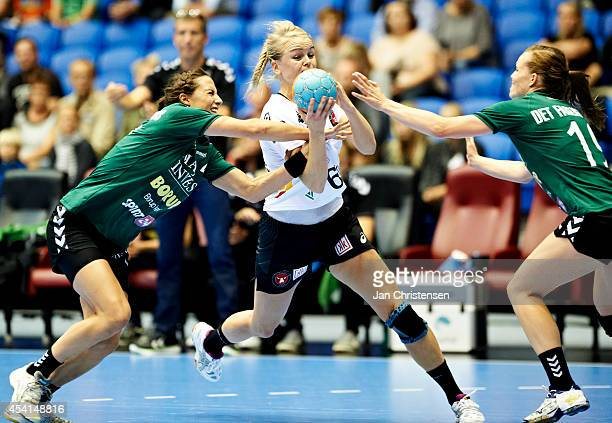 Louise Burgaard of Viborg HK Stine Jorgensen of FC Midtjylland and Louise Lyksborg of Viborg HK challenge for the ball during the Super Cup Final...