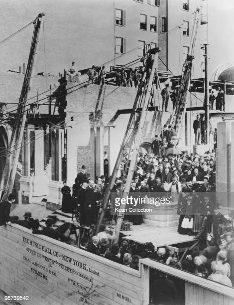 Louise Carnegie, silver trowel in hand, presides over the laying of the Carnegie Hall cornerstone on 15, May, 1890. Andrew Carnegie can be seen...