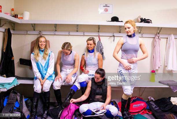 Louise Day Mikayla Weir Wendy Peel Rhiannon Payne and Brooke Stower resume race preparations after posing for a photo in the jockeys room during...