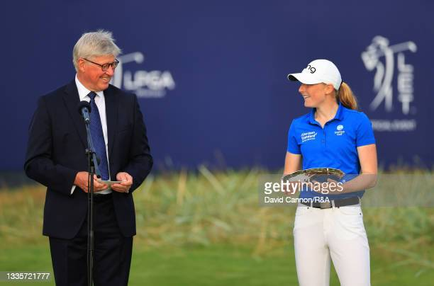 Louise Duncan of Scotland, the leading Amateur, speaks with Martin Slumbers, Chief Executive of The R&A during the presentation ceremony following...