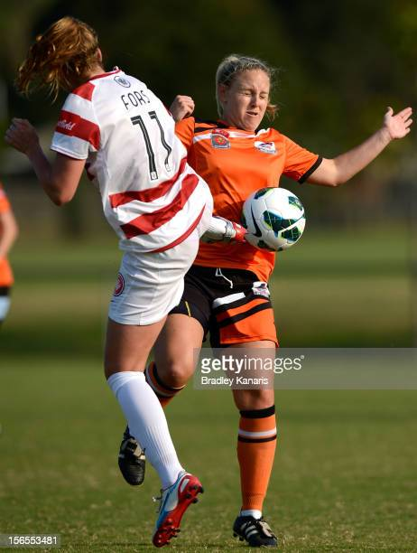 Louise Fors of the Wanderers and Georgia Chapman of the Roar collide as they compete for the ball during the round five W-League match between...