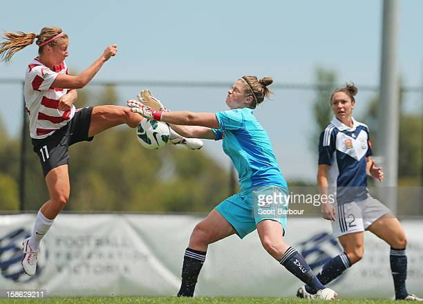 Louise Fors of the Wanderers and goalkeeper Brianna Davey of the Victory compete for the ball during the round 10 WLeague match between the Melbourne...