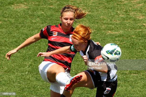 Louise Fors of the Wanderers and Tori Huster of the Jets contest possession during the round six WLeague match between the Western Sydney Wanderers...