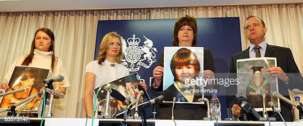 Louise Hawker, Lisa Hawker, Julia Hawker and Bill Hawker hold picture of their family member Lindsay Ann Hawker attend the press conference appealing...