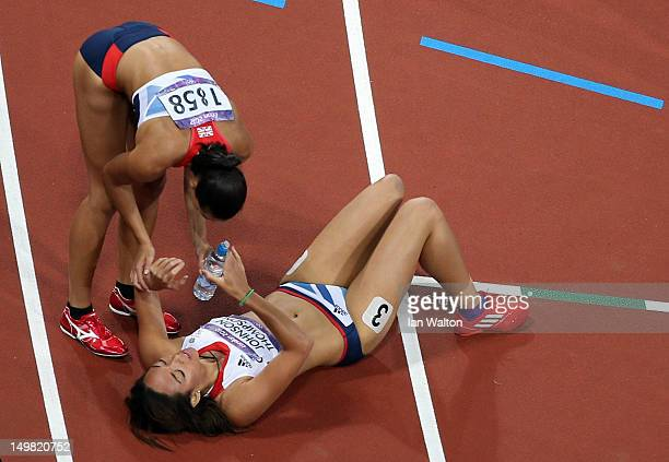 Louise Hazel checks on teammate Katarina JohnsonThompson of Great Britain after competing in 800m portion of the Women's Heptathlon during Day 8 of...