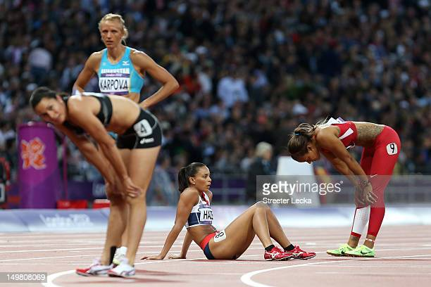 Louise Hazel of Great Britain sits on the track after competing in the Women's Heptathlon 800m on Day 8 of the London 2012 Olympic Games at Olympic...