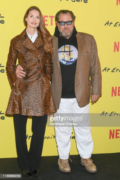 Louise Kugelberg and Julian Schnabel attend At Eternity's Gate Photocall at Musee du Louvre on April 02 2019 in Paris France