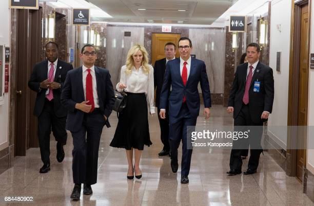Louise Linton and Treasury Secretary Steven Mnuchin walk on Capital Hill to testify at a Senate Banking Committee and International Policy hearing on...
