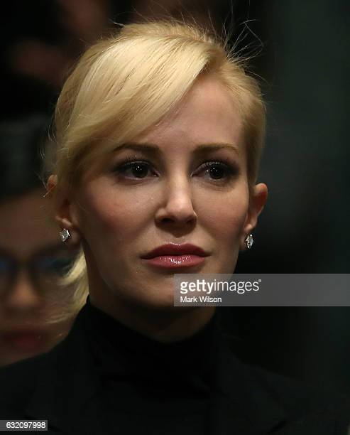 Louise Linton listens to her fiancee, Treasury Secretary nominee, Steven Mnuchin's Senate Finance committee confirmation hearing on Capitol Hill, on...
