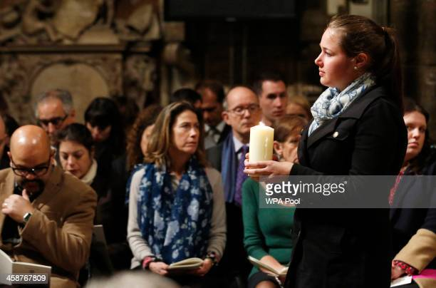 Louise Mann holds a memorial candle for the victims of the Lockerbie bombing during a service of remembrance to mark the 25th anniversary of the...
