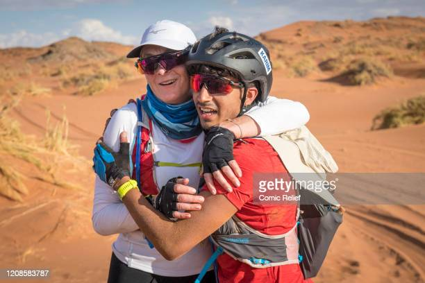Louise Minchin and Karim Zeroual hug on Day 1 of the Sport Relief challenge The Heat is On as the team sets off on February 24 2020 in the Namib...