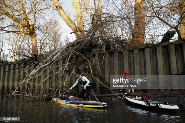 Louise Nolan and James Roorda collect discarded plastic and rubbish from the banks of the River Thames near Kew Bridge west London on January 16 2018...