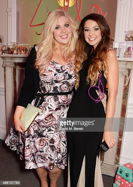 Louise Pentland and Zoe Sugg attends YouTube phenomenon Zoe Sugg's launch of her debut beauty collection at 41 Portland Place on September 25 2014 in...