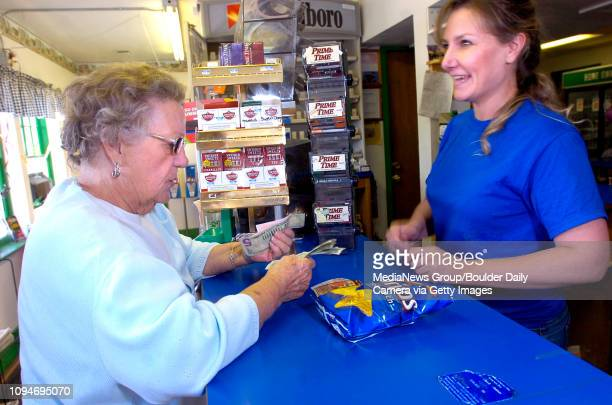 Louise Peterson of Longmont at left purchases a lottery ticket from Elaine Wents at the Country Corner Store on Monday September 28 2009 Saturday's...