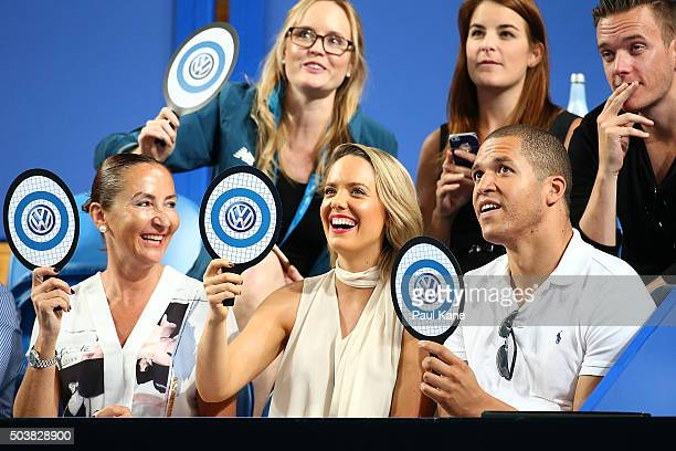 Louise Pillidge and Blake Garvey look on while watching the womens single match between Victoria Duval of the United States and Karolina Pliskova of...
