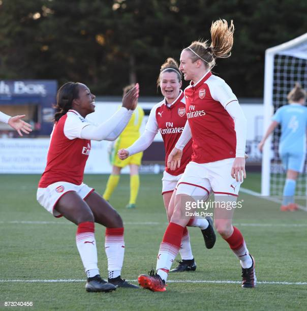 Louise Quinn celebrates scoring a goal for Arsenal with Daniell Carter and Emma Mitchell during the WSL match between Arsenal Women and Sunderland on...