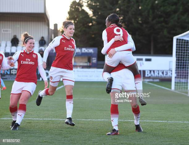 Louise Quinn celebrates scoring a goal for Arsenal with Danielle Carter Emma Mitchell and Dominique Janssen during the WSL match between Arsenal...