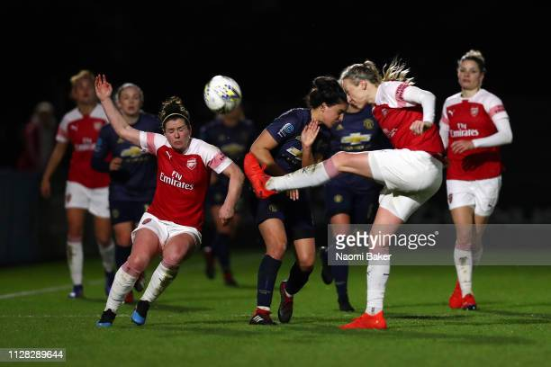 Louise Quinn of Arsenal clears the ball during the FA WSL Cup match between Arsenal Women and Manchester United Women at Meadow Park on February 07...