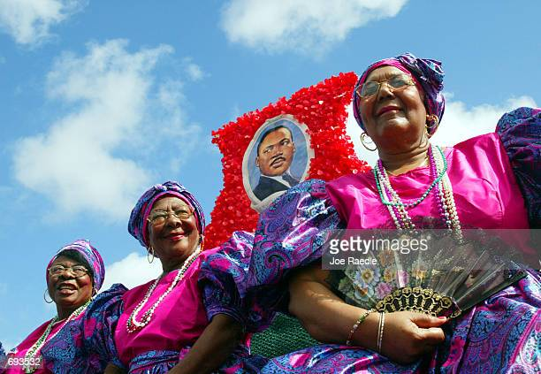 Louise Sama Marie Leonard and Ginette Etienne ride on a float during the Liberty City Parade in honor of slain civil rights leader Martin Luther King...
