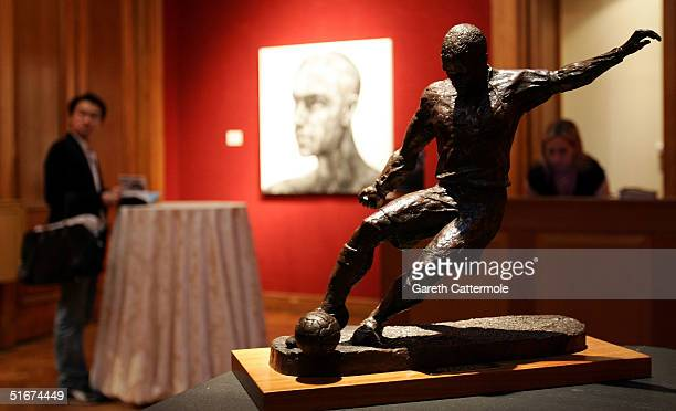 Louise Simson's lot 'Winning Goal' is seen ahead of an auction of sculptures paintings and photographs inspired by modernday football legend David...