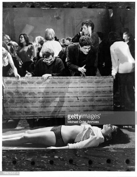 Louise Sorel lies motionless in a scene from the film 'The Party's Over' 1965 Photo by Allied Artists/Getty Images