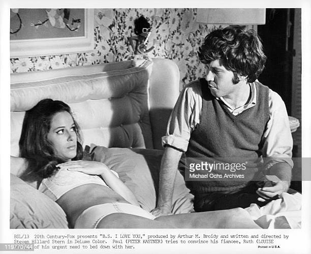 Louise Sorel listens to Peter Kastner in bed in a scene from the film 'BS I Love You' 1971