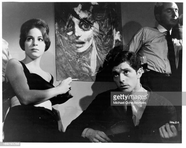 Louise Sorel smokes with Clifford David in a scene from the film 'The Party's Over' 1965 Photo by Allied Artists/Getty Images