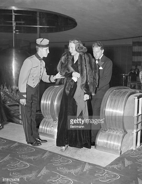Louise Teddy Lynch and J Paul Getty with a bellhop at the opening of the International Casino Getty is famous for being an oil billionaire and for...
