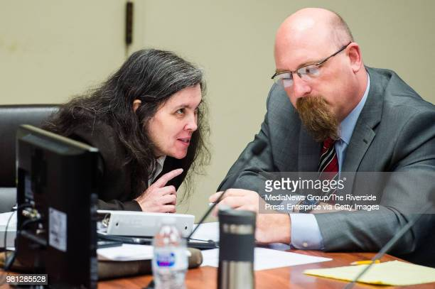 Louise Turpin left talks to her attorney Jeff Moore as she appears in Superior Court in Riverside County Calif on Wednesday June 20 2018 for a...