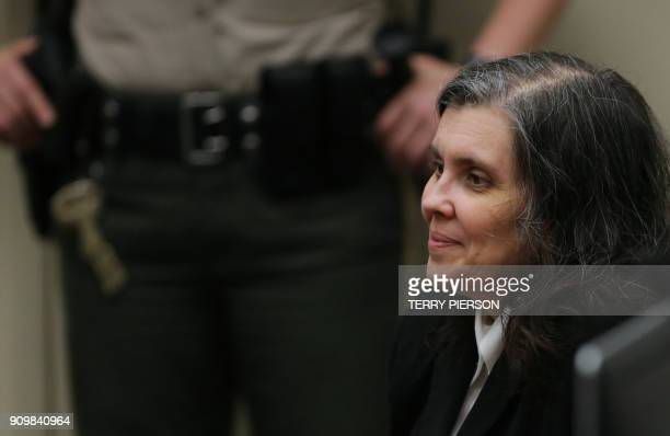Louise Turpin smiles in court on January 24 2018 in Riverside California David Allen Turpin and his wife Louise Anna Turpin 49 who had registered...
