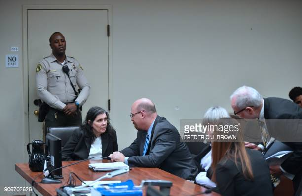 Louise Turpin speaks with attorney Jeff Moore as David Turpin speaks with attorneys David Macher and Allison Lowe during their court arraignment in...