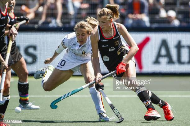 Louise Versavel of Belgium vies with Hanna Granitzki of Germany during the European field Hockey Championship match between Germany and Belgium at...