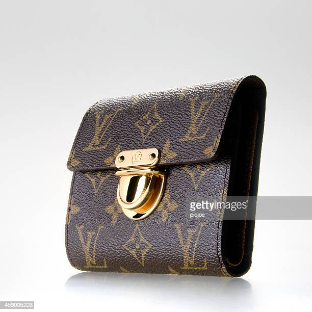 louise vuitton wallet for women - louis vuitton designer label stock pictures, royalty-free photos & images