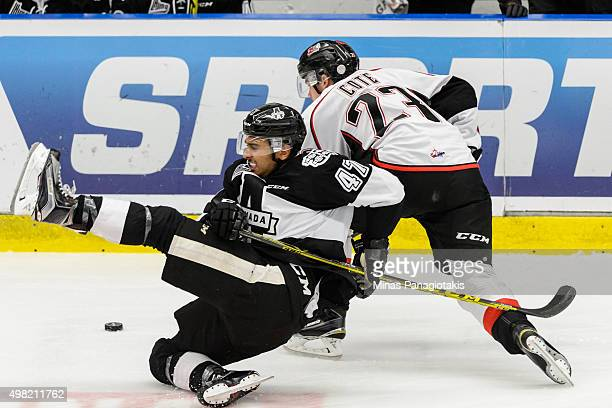 LouisFilip Cote of the Huskies de RouynNoranda takes down Olivier SchinghGomez of the BlainvilleBoisbriand Armada during the QMJHL game at the Centre...