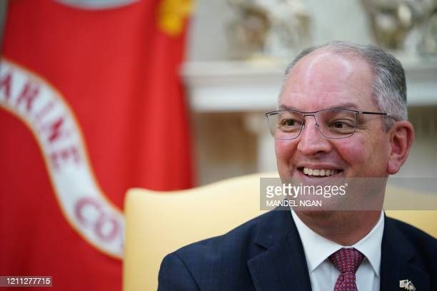 Louisiana Democratic Governor John Bel Edwards meets with US President Donald Trump in the Oval Office of the White House in Washington, DC, on April...