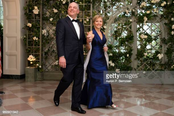 Louisiana Gov John Bel Edwards and his wife Donna arrive at the White House for a state dinner April 24 2018 in Washington DC President Donald Trump...