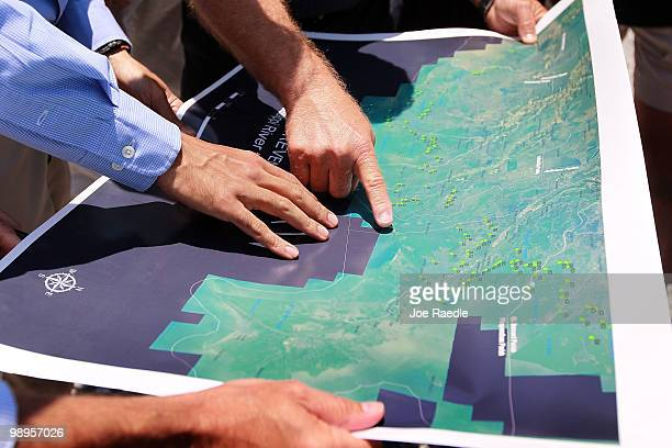 Louisiana Governor Bobby Jindal and Grand Isle Mayor David Camardelle look at a map together showing the areas that might be affected by BP's massive...