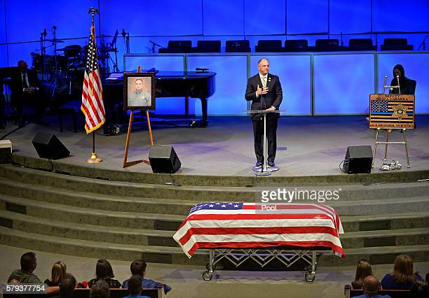 Louisiana Governor John Bel Edwards speaks during the funeral services for East Baton Rouge Sheriff deputy Brad Garafola at the Istrouma Baptist...
