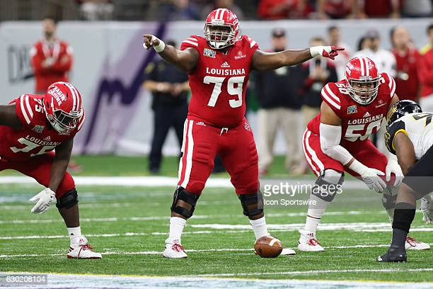 Louisiana Lafayette offensive lineman Eddie Gordon points out defensive positioning in the RL Carrier New Orleans Bowl on December 17 at The...