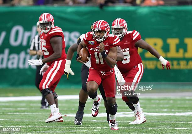 Louisiana Lafayette quarterback Anthony Jennings runs the ball for a first down in the RL Carrier New Orleans Bowl on December 17 at The MercedesBenz...