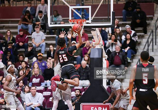 Louisiana Lafayette Ragin Cajuns forward Roydell Brown shoots over Arkansas Little Rock Trojans forward Oliver Black during an NCAA basketball game...