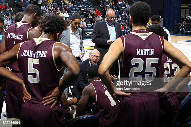 Louisiana Monroe Warhawks head coach Keith Richard speaks to his boys during a timeout in the first half of the NCAA Men's basketball game between...
