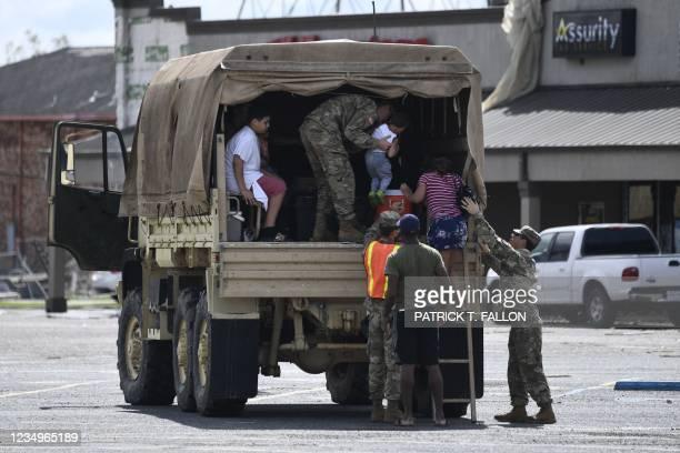 Louisiana National Guard truck assists people in Laplace, Louisiana, on August 30, 2021 after Hurricane Ida made landfall. - Powerful Hurricane Ida...