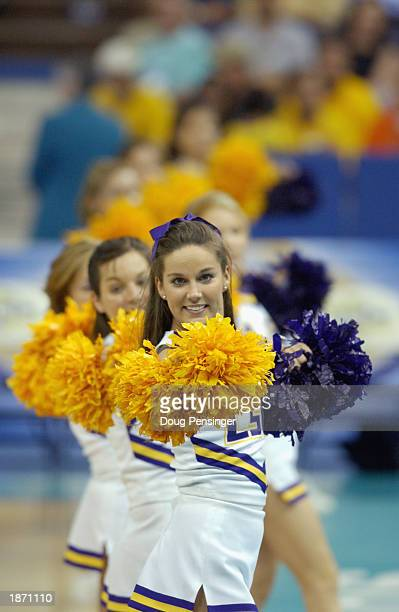 Louisiana State University cheerleaders entertain the fans during the SEC Men's Basketball Tournament game between the Louisiana State University...