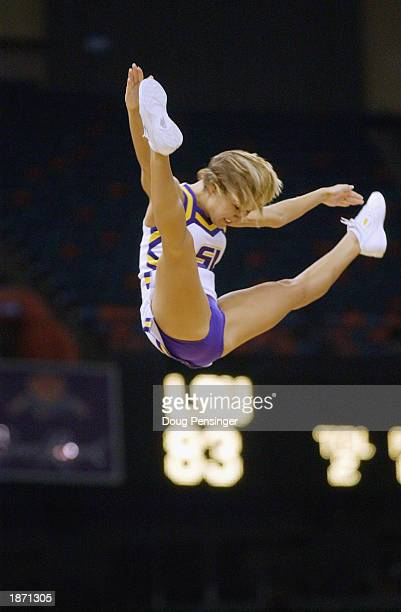 Louisiana State University cheerleaders perform high flying stunts for the fans during the SEC Men's Basketball Tournament game between the Louisiana...