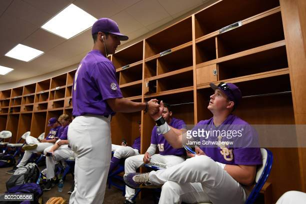 Louisiana State University players shake hands in the locker room before they take on the University of Florida during the Division I Men's Baseball...