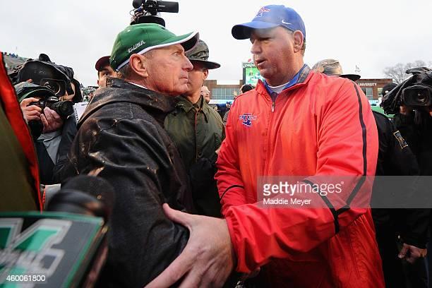 Louisiana Tech Bulldogs coach Skip Holtz congratulates Marshall Thundering Herd head coach Doc Holliday at Joan C Edwards Stadium after the...