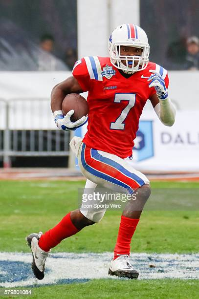 Louisiana Tech Bulldogs defensive back Xavier Woods intercepts a pass and returns it for a touchdown during the Zaxby's Heart of Dallas Bowl between...