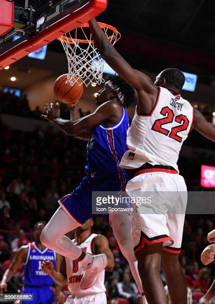 Louisiana Tech Bulldogs guard Jalen Harris goes up and under Western Kentucky Hilltoppers forward Dwight Colby during the first half between the...