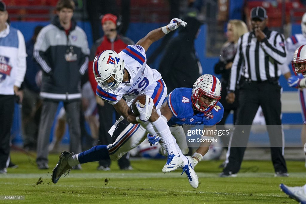 Louisiana Tech Bulldogs wide receiver Adrian Hardy (89) is tripped up by Southern Methodist Mustangs safety Mikial Onu (4) during the DXL Frisco Bowl game between the Louisiana Tech Bulldogs and SMU Mustangs on December 20, 2017 at Toyota Stadium in Frisco, TX.